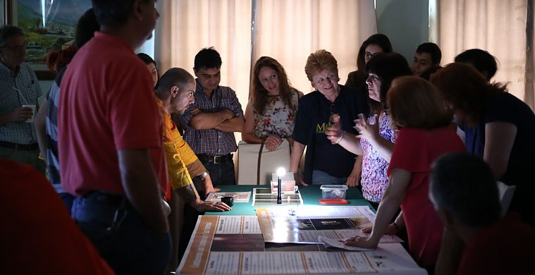 Astro-photographers, local teachers, astronomers and staff from the La Palma Office of Tourism explore the Quality Lighting Teaching Kit activities at the Starlight, Beyond Light Pollution workshop on the Canary Islands. Credits: Valentin Grigore (President of the Romanian Society for Meteors and Astronomy)