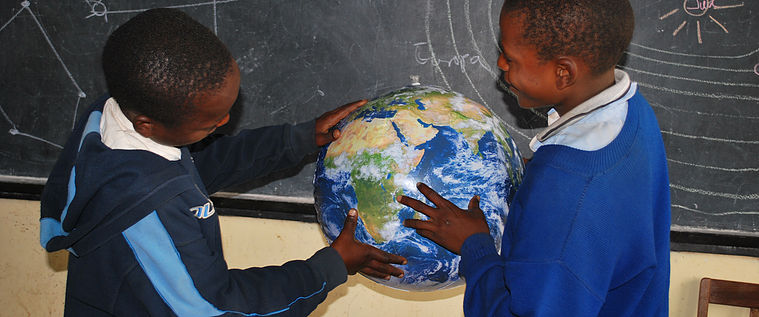 Children holding an Earthball. Credit: UNAWE