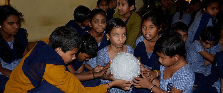 Group of learners exploring a 3D Moon model during A Touch of the Universe activity in India. Credit: A Touch of the Universe.